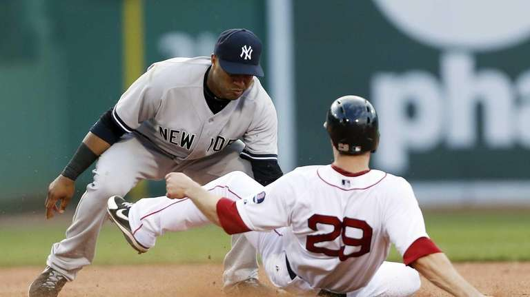 Robinson Cano, left, tags out Boston Red Sox's