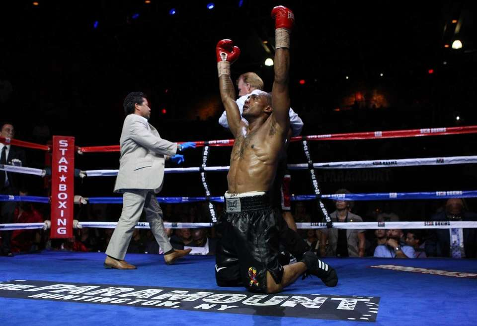 Jonathan Cuba of Queens celebrates after knocking out