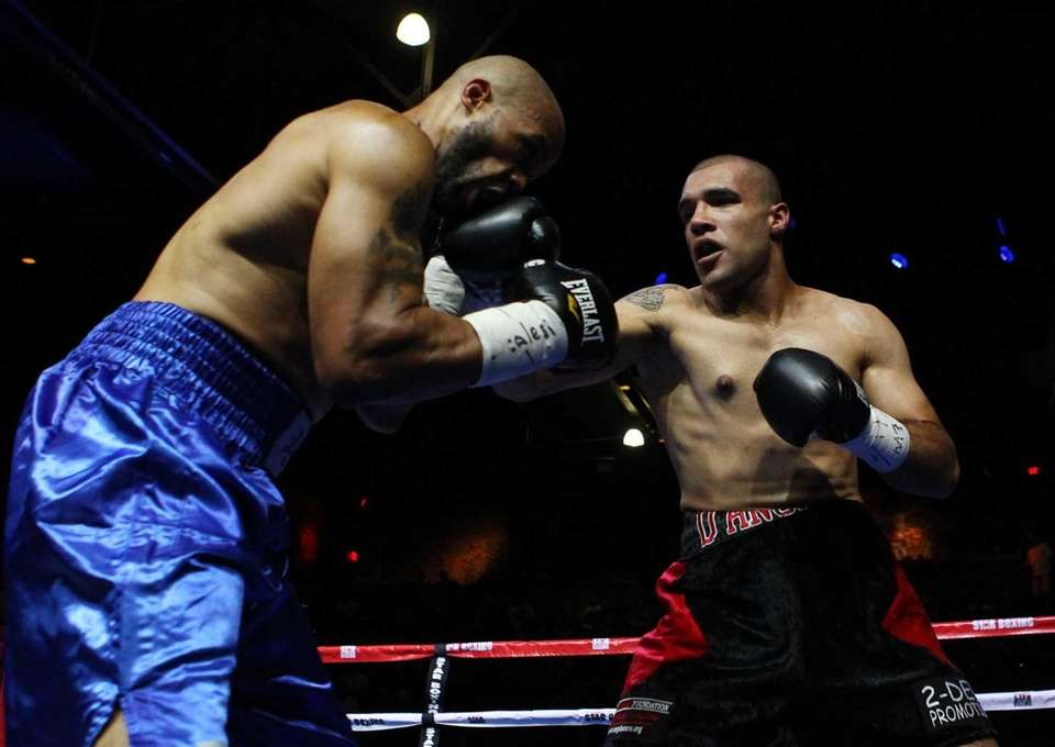 Vincenzo D'Angelo of Huntington fights Michael Mitchell at