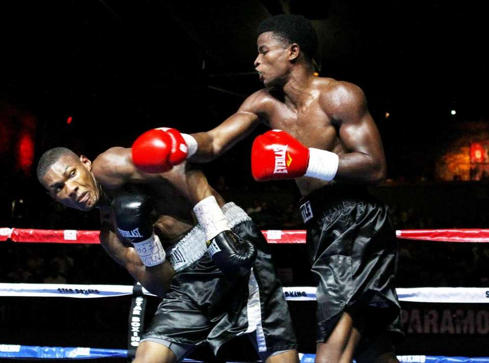 Wendy Toussaint connects on a right hook against