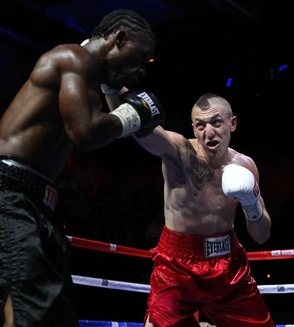 Alan Gotay, right, of Huntington fights Michael Doyle