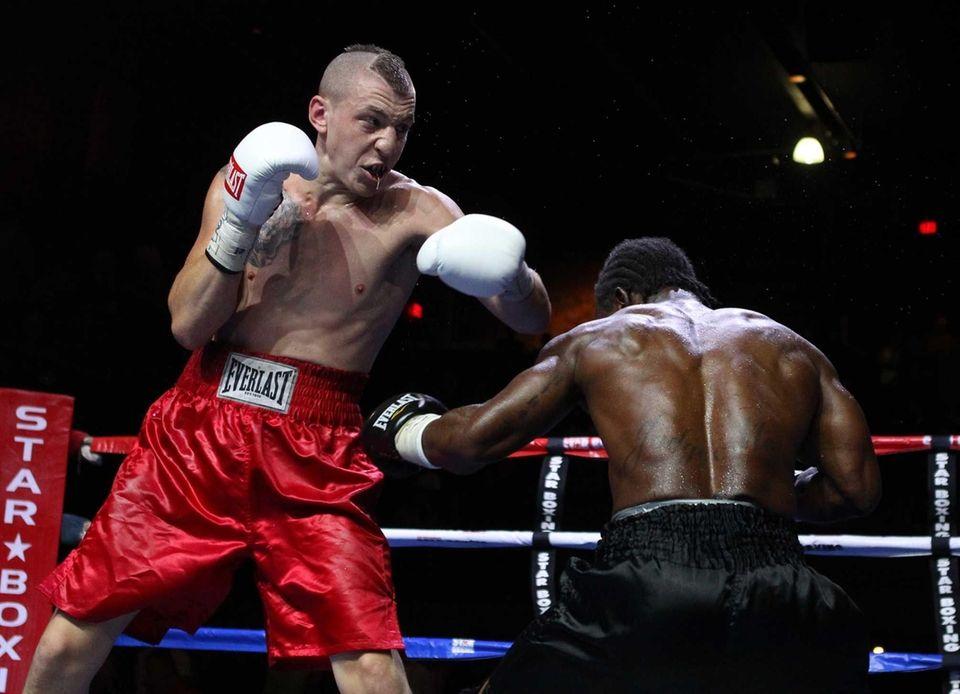 Alan Gotay, left, of Huntington fights Michael Doyle