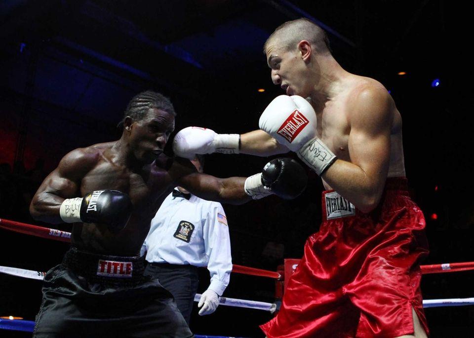 Alan Gotay, right, of Huntington fights Michael Doyle