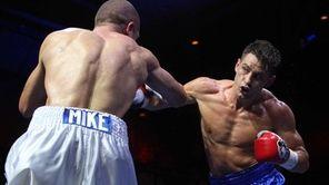 Chris Algieri of Huntington, right, fights Mike Arnaoutis