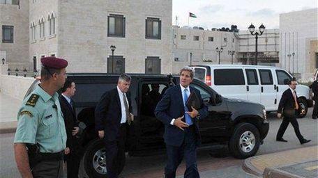 U.S. Secretary of State John Kerry steps out