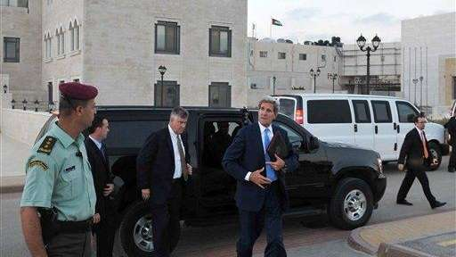 U.S. Secretary of State John Kerry steps out