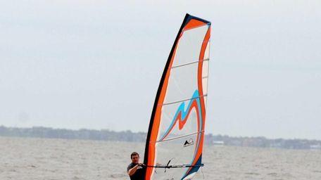 Luis Cerqueira, of Kings Park, windsurfs off Heckscher