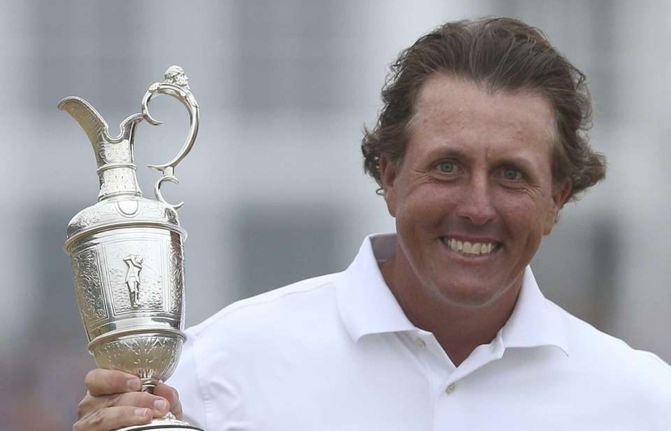 Phil Mickelson of the United States holds up