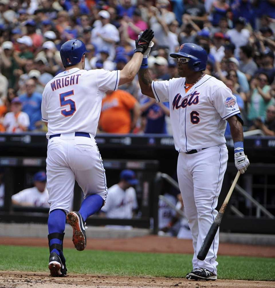 David Wright is congratulated by Marlon Byrd on