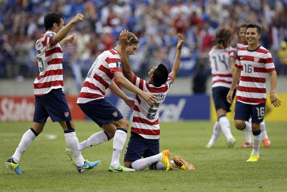 Teammates celebrate with United States' Joe Corona (6)
