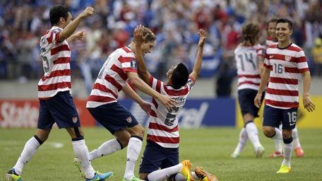 Teammates celebrate with United States' Joe Corona (6)