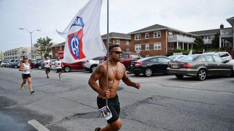 Darin Faccilonga of Long Beach runs down Broadway
