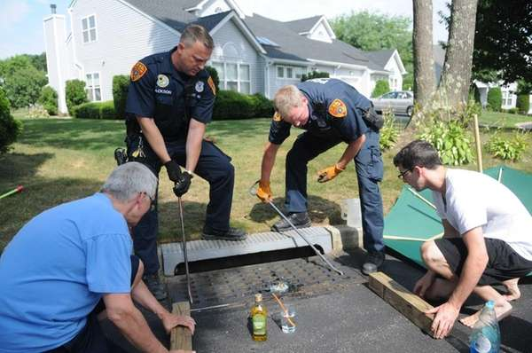 Suffolk County police emergency service officers work on