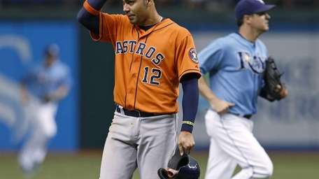 Houston Astros hitter Carlos Pena, left, reacts after