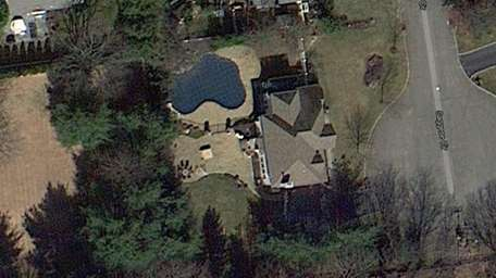 A satellite image of the home at 4