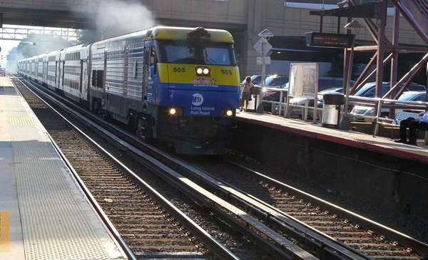 Diesel train comes though as commuters wait for