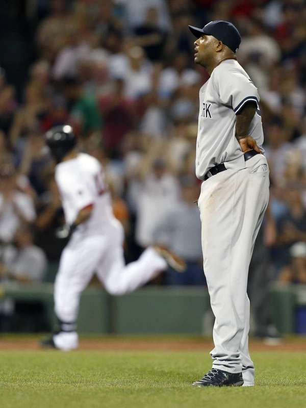 CC Sabathia looks on as Boston Red Sox