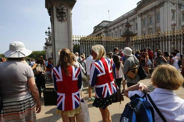 People gather outside Buckingham Palace in London. (July