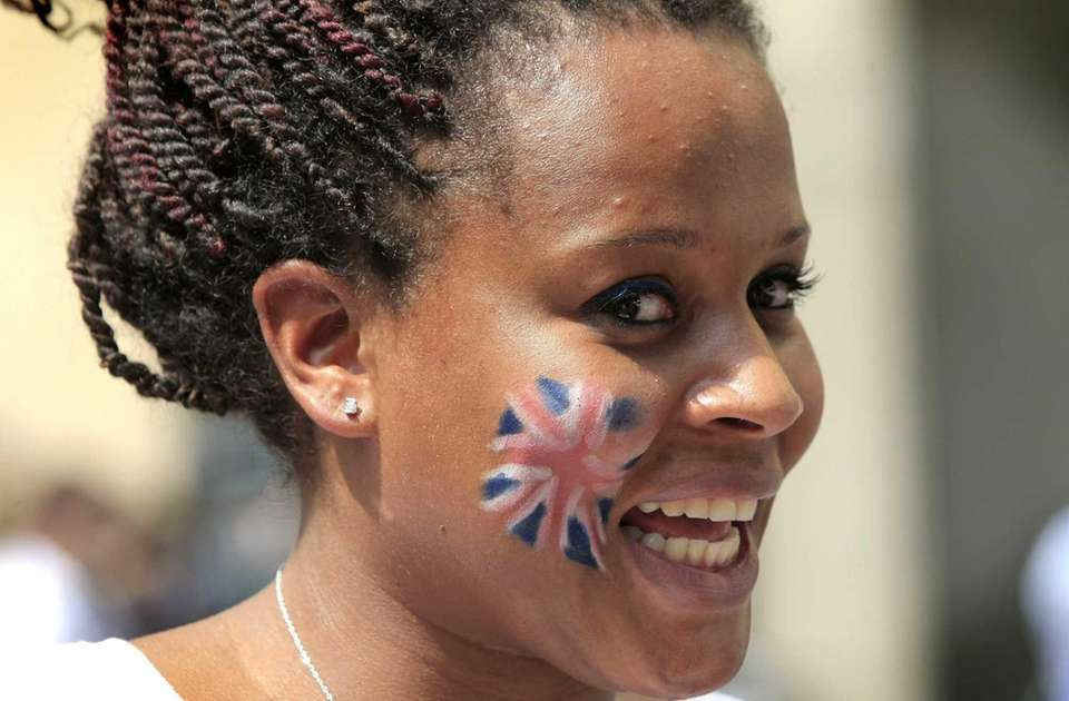 A woman with a British flag face painting