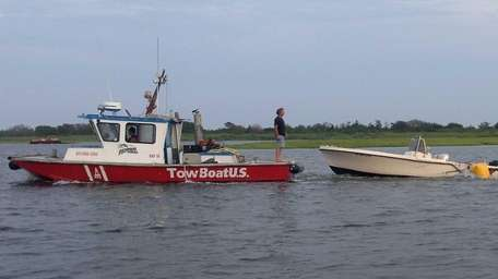 A boat is towed after two people were