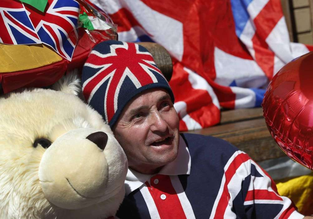 Royal supporter John Loughrey with royal baby memorabilia