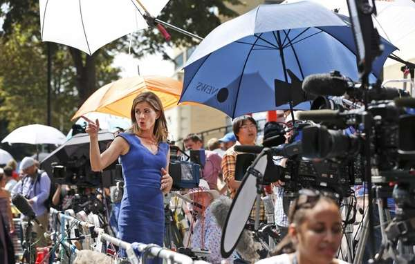 Natalie Morales of NBC broadcasts a live report,