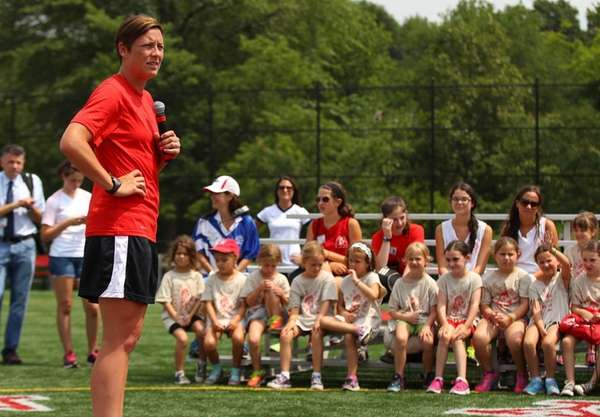 Professional soccer player Abby Wambach speaks to camper