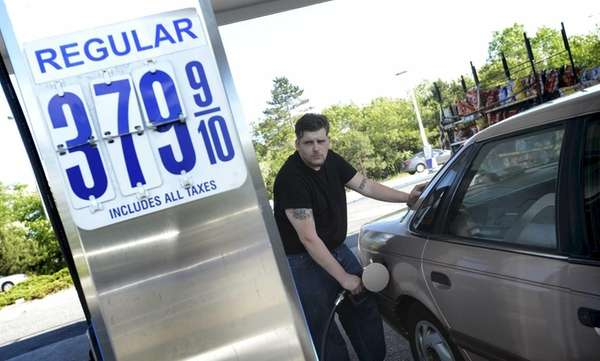 Michael Connolly, of Port Jefferson Station, fuels up