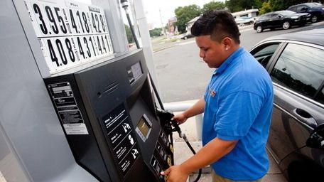 An attendant fills a customer's tank at Performance