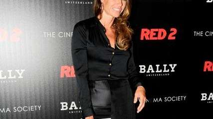 Kelly Bensimon, carrying a Bally tote