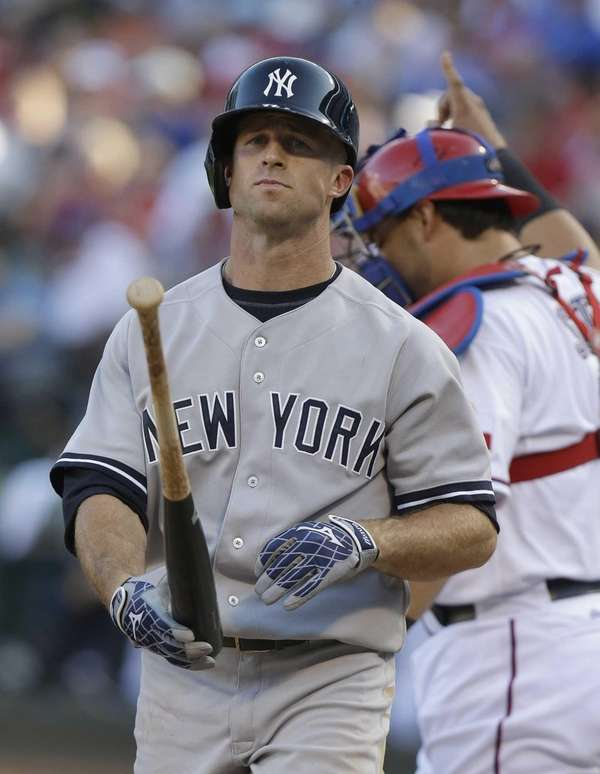 Brett Gardner heads back to the dugout after