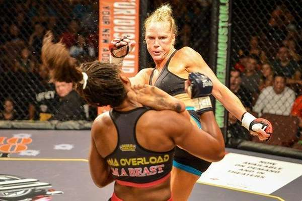 Holly Holm, background, knocks out Allanna Jones with