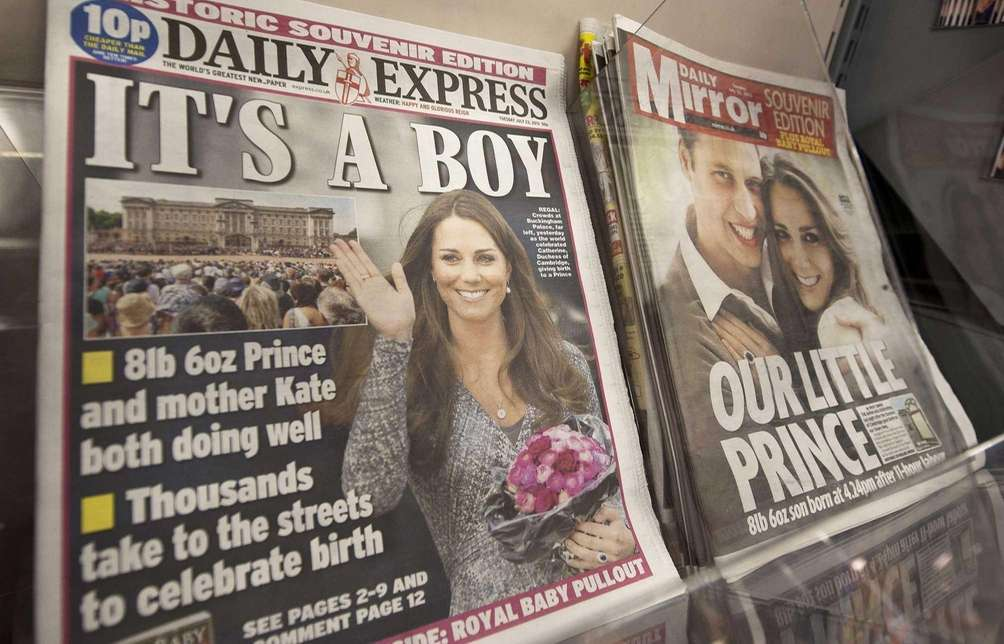 Newspaper front pages report news of the birth