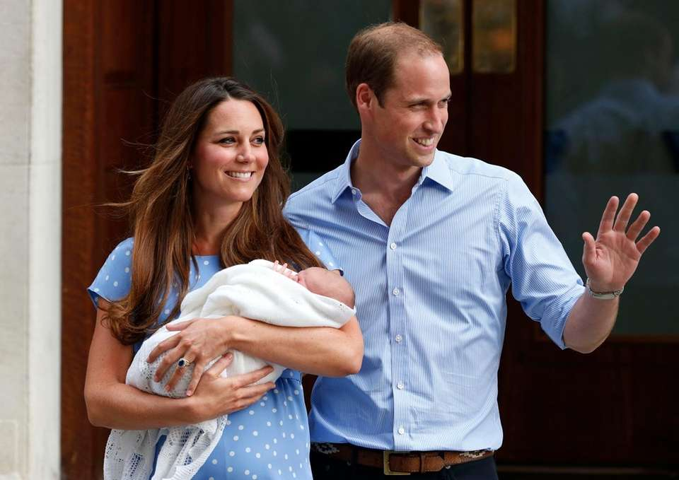 Britain's Prince William and Kate hold the Prince