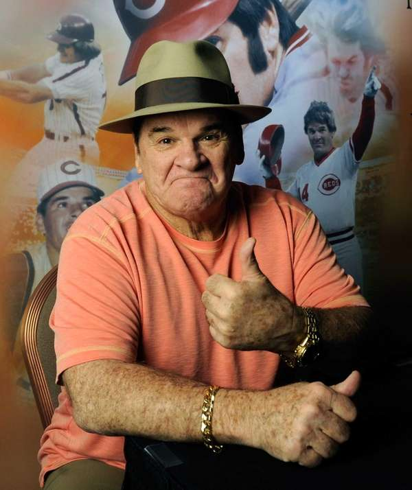 Pete Rose poses for a photograph before signing