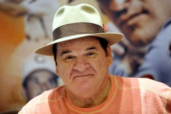 Pete Rose smiles as he waits for his