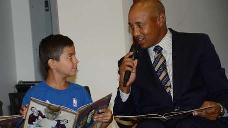 New York Knicks' fan Oliver Membreno, 8, of