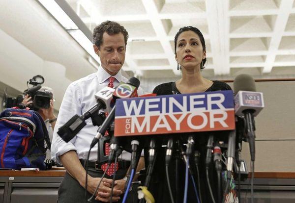 New York mayoral candidate Anthony Weiner, left, listens