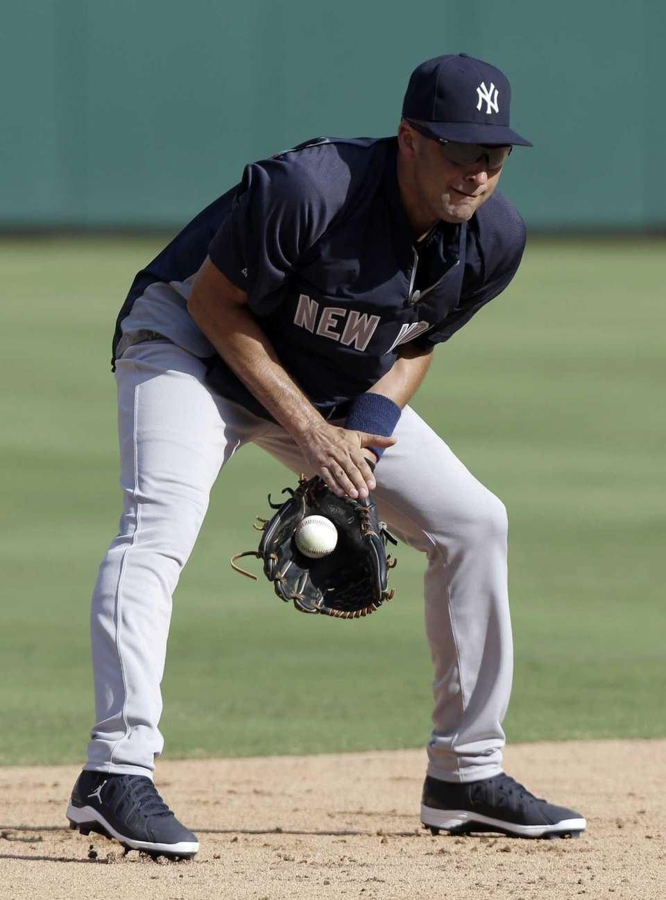 New York Yankees shortstop Derek Jeter fields grounders