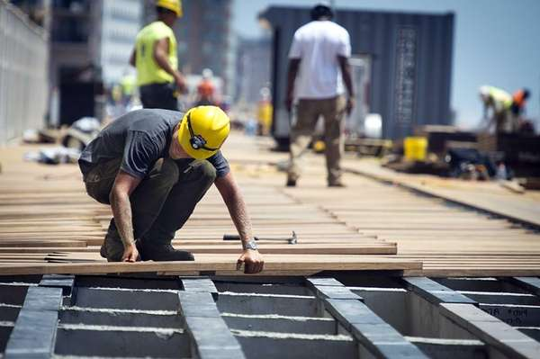 Construction workers repairthe boardwalk in Long Beach. (July