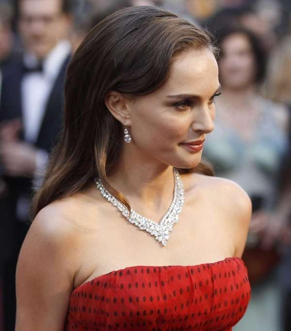 Natalie Portman arrives before the 84th Academy Awards