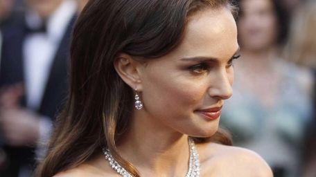 Natalie Portman arrives before the 84th Academy Awards