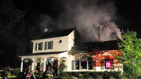 Firefighters at the scene of a blaze, reported