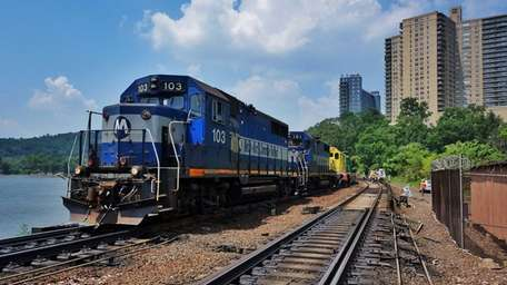 Crews work to remove derailed freight cars and