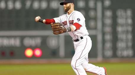 Dustin Pedroia #15 of the Red Sox makes