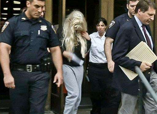 Amanda Bynes being escorted after a criminal court