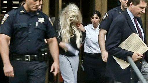 Amanda Bynes being escorted after a criminal court
