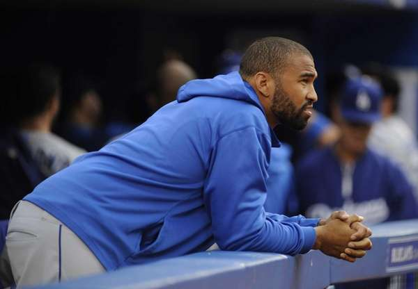Los Angeles Dodgers outfielder Matt Kemp watches from