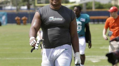 Miami Dolphins tackle Jonathan Martin walks off the