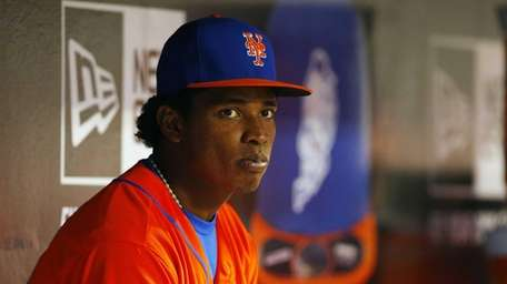Jenrry Mejia of the Mets looks on from